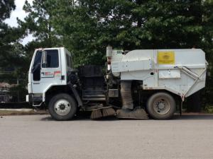 Street sweeper vehicle on the road.