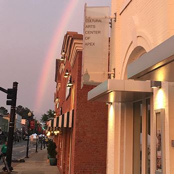 Exterior of arts center with rainbow